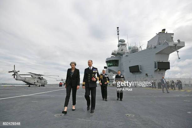Britain's Prime Minister Theresa May talks with Commodore Jerry Kyd Captain of the 65000tonne British aircraft carrier HMS Queen Elizabeth after it...