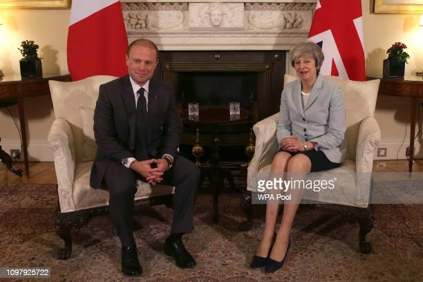 Britain's Prime Minister Theresa May talks with Malta's Prime Minister Joseph Muscat during their meeting inside Downing Street on February 11 2019...