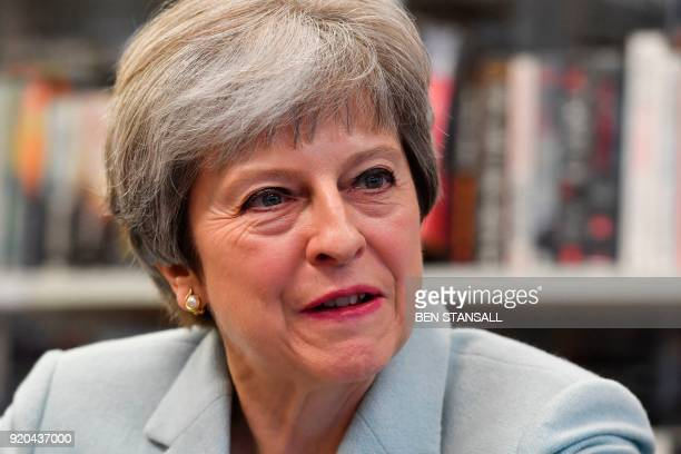 Britain's Prime Minister Theresa May talks with pupils and staff during a visit to Featherstone High School in West London on February 19 2018 The...