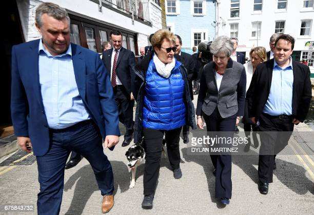Britain's Prime Minister Theresa May talks with residents as she walks in Mevagissey southwest England on May 2 during a campaign visit ahead of the...