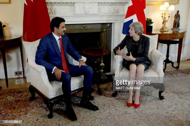 Britain's Prime Minister Theresa May talks with the Emir of Qatar Sheikh Tamim Bin Hamad alThani at the start of their meeting inside 10 Downing...