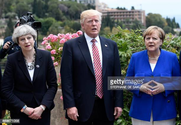 Britain's Prime Minister Theresa May US President Donald Trump and German Chancellor Angela Merkel arrive to watch an Italian flying squadron during...