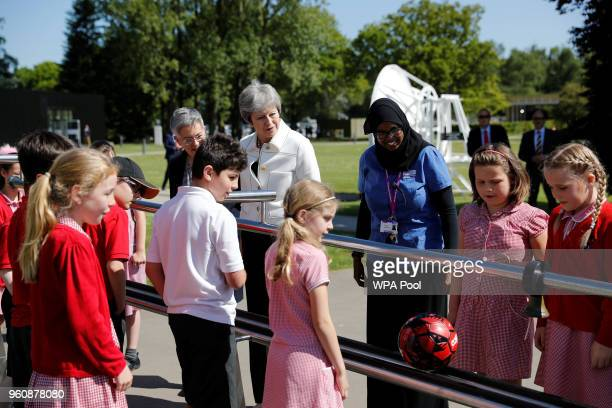 Britain's Prime Minister Theresa May visits a local school before delivering a speech on science and the Industrial Strategy on May 21 2018 in...
