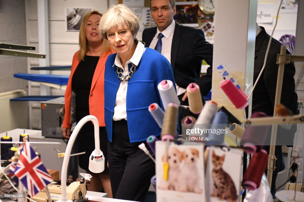 Britain's Prime Minister Theresa May visits Simon Jersey, a business uniform supplier in the constituency of Hyndburn in Accrington, Lancashire county on May 30, 2017. / AFP PHOTO / POOL / Leon Neal