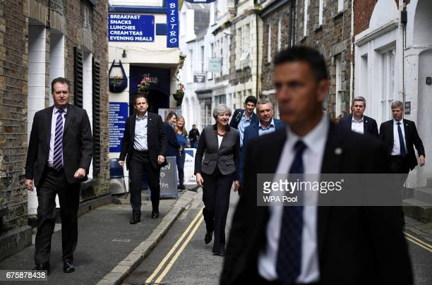 Britain's Prime Minister Theresa May walks during a campaign stop on May 2 2017 in Mevagissey Cornwall England The Prime Minister is campaigning in...