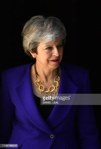 Britain's Prime Minister Theresa May walks out of 10 Downing street to greet the Prime Minister of Iceland, Katrín Jakobsdottir in central London on...