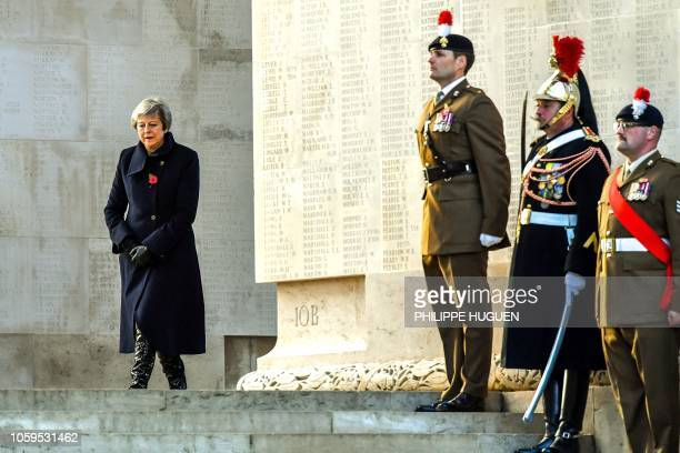 Britain's Prime Minister Theresa May walks past French and British soldiers during a ceremony marking the 100th anniversary of the end of the World...