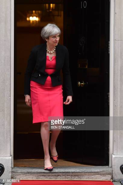 Britain's Prime Minister Theresa May walks to meet Spanish King Felipe VI outside 10 Downing Street in London on July 13 the second day of the...