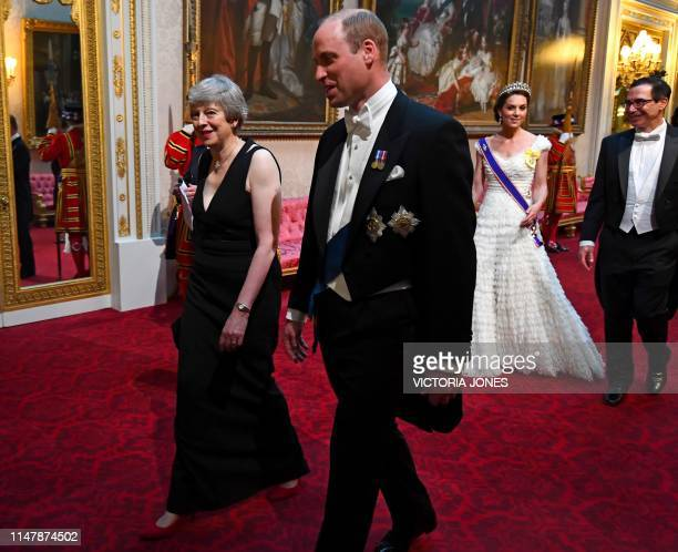 Britain's Prime Minister Theresa May walks with Britain's Prince William, Duke of Cambridge followed by Britain's Catherine, Duchess of Cambridge and...