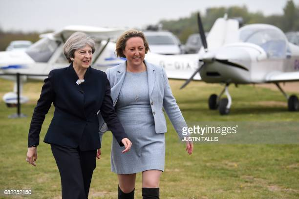 Britain's Prime Minister Theresa May walks with Conservative party candidate for BerwickuponTweed AnneMarie Trevelyan before addressing supporters...