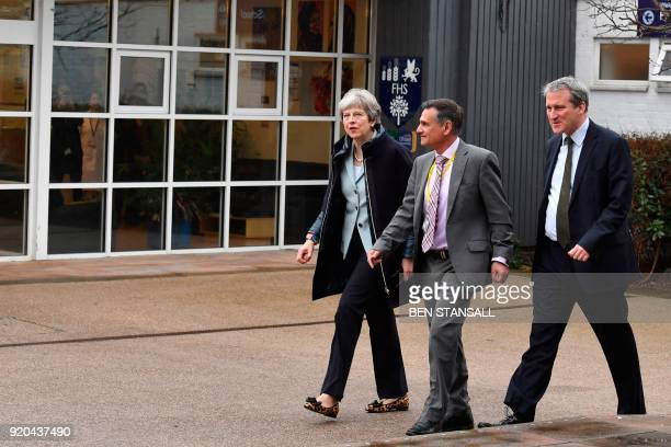 Britain's Prime Minister Theresa May walks with headteacher Gerry Wadwa as she visits Featherstone High School in West London on February 19 2018 The...