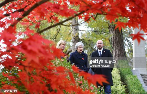 Britain's Prime Minister Theresa May walks with Liz Sweet of the Commonwealth War Graves Commission and Belgium's Prime Minister Charles Michel at...