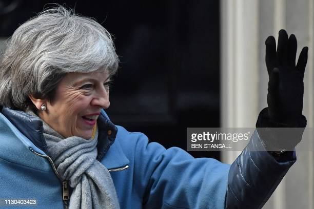 Britain's Prime Minister Theresa May waves as she leaves 10 Downing Street in London on March 14 ahead of a further Brexit vote British MPs will vote...