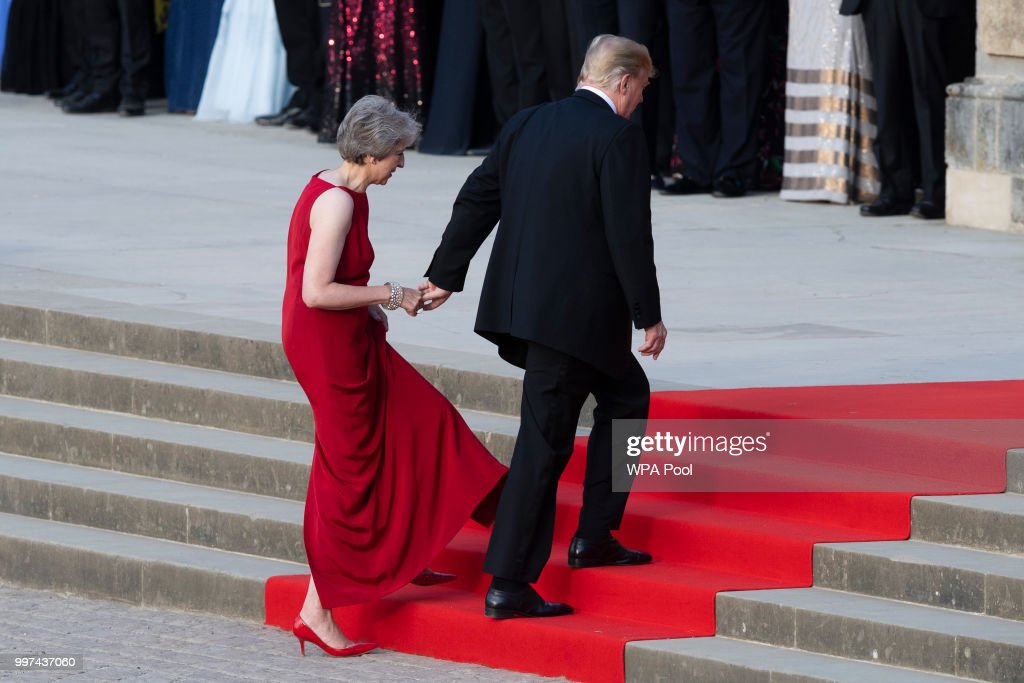 Britain's Prime Minister Theresa May welcomes U.S. President Donald Trump at Blenheim Palace on July 12, 2018 in Woodstock, England. Blenheim Palace is the birth place of the great wartime British Prime Minister, Winston Churchill, of whom the President is a big fan. The Prime Minister hosted dinner for the President and First Lady and business leaders as part of the First Couple's official visit to the UK.