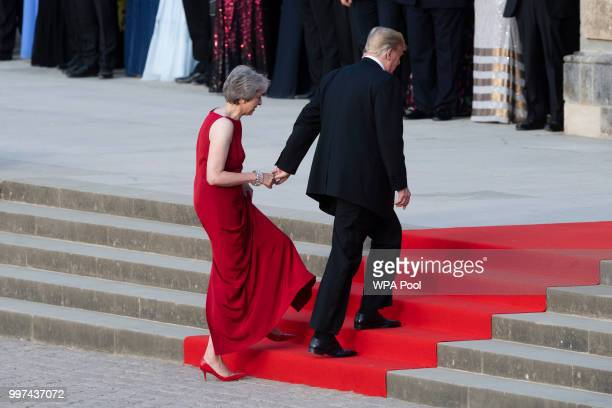 Britain's Prime Minister Theresa May welcomes US President Donald Trump at Blenheim Palace on July 12 2018 in Woodstock England Blenheim Palace is...