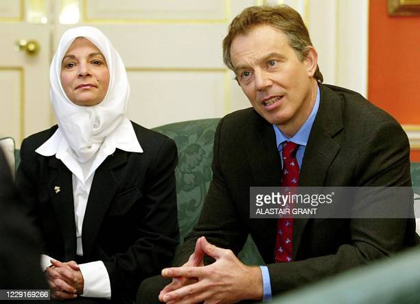 Britain's Prime Minister Tony Blair and Hayfaa Abdul, a Shi'ite Iraqi, listen to five Iraqis who live in exile during a meeting at 10 Downing Street...