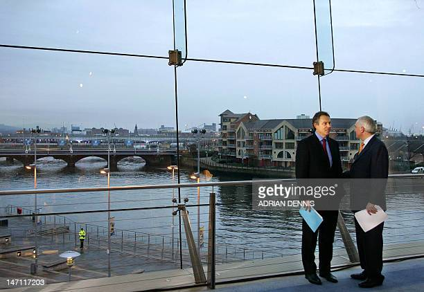 Britain's Prime Minister Tony Blair and Irish Prime Minister Bertie Ahern speak after their press briefing at the Waterfront Centre beside the River...