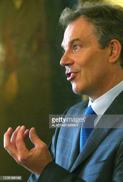 Britain's Prime Minister Tony Blair answers a question from the media at 10 Downing Street, in London 01 May 2003, on the political situation in...