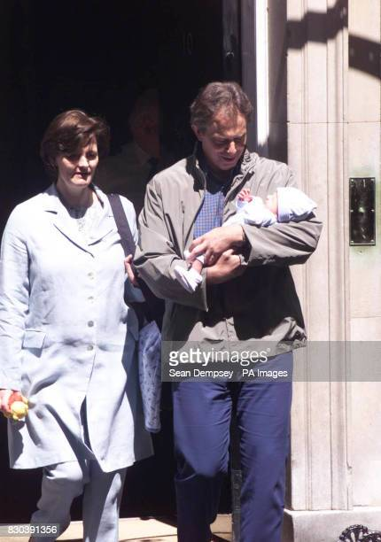Britain's Prime Minister Tony Blair cradles his new born son Leo with Cherie as they leave 10 Downing Street in London for the Prime Minister's...