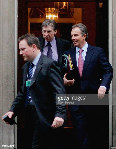 Britain's Prime Minister Tony Blair departs Downing Street watched by police officers and security officials on January 18 2006 in London England A...