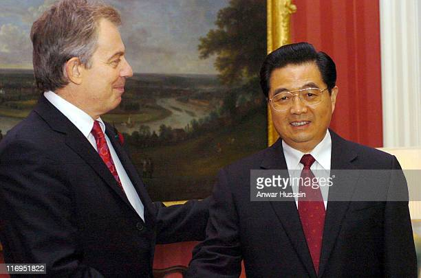 Britain's Prime Minister Tony Blair greets President Hu Jintao of China inside 10 Downing Street, The President is in the country on a state visit