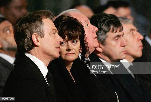 Britain's Prime Minister Tony Blair , his wife Cherie , Chancellor of the Exchequer Gordon Brown and Foreign Secretary Jack Straw attend a service in...