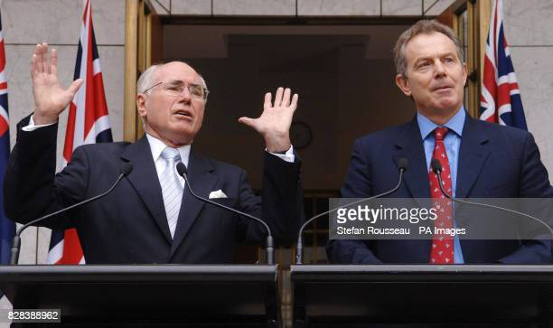 Britain's Prime Minister Tony Blair holds a joint news conference with his Australian counterpart John Howard at Parliament House in Canberra Tuesday...