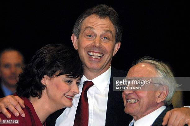 Britain's Prime Minister Tony Blair hugs his wife Cherie and father Leo after the official count at the Newton Aycliffe Leisure Centre early Friday...