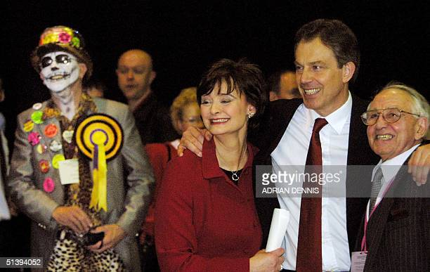 Britain's Prime Minister Tony Blair hugs his wife Cherie and father Leo while Christopher Driver candidate for The Rock n' Roll Loony Party looks on...