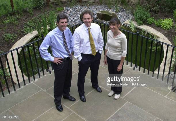Britain's Prime Minister Tony Blair in front of the new Downing Street pond with the ponds designer Julie Toll and the director general of the...