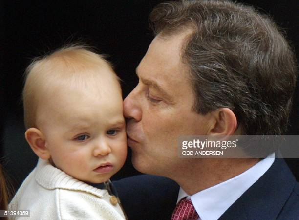Britain's Prime Minister Tony Blair kisses his son Leo on the step to No 10 Downing Street London 08 June 2001 Blair posed with his family on the...