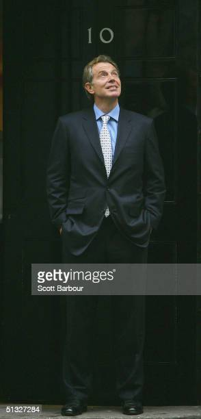 Britain's Prime Minister Tony Blair looks skyward as it rains as he waits to greet Indian Prime Minister Manmohan Singh on the doorstep of 10 Downing...