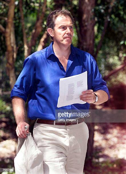 Britain's Prime Minister Tony Blair makes his way to the Commonwealth Heads of Government Meeting March 4 2002 at Coolum Sunshine Coast Australia...