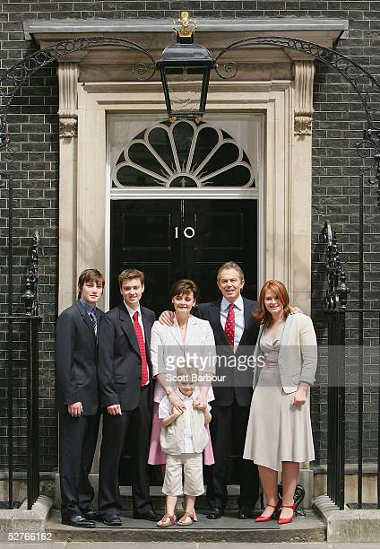 Britain's Prime Minister Tony Blair poses for photographers along with his family sons Nicky Euan wife Cherie son Leo and daughter Kathryn after...