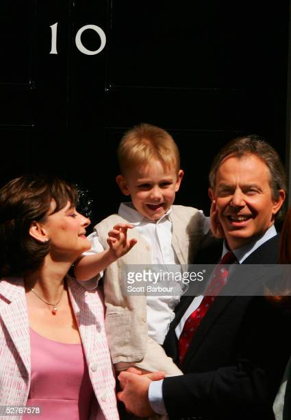 Britain's Prime Minister Tony Blair poses for photographers with son Leo and wife Cherie on the doorstep after returning to 10 Downing Street on May...
