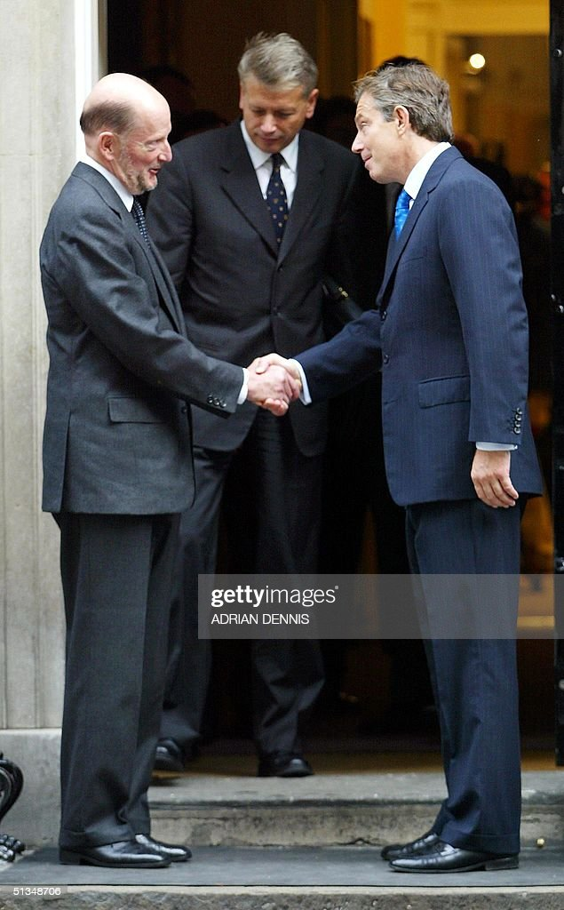 Britain's Prime Minister Tony Blair (R) shakes hands with Bulgarian Prime Minister Simeon Saxe-Coburg (L) outside No. 10 Downing Street in London 08 October 2002. Prime Minister Saxe-Coburg is in Britain on a three-day official visit. AFP PHOTO Adrian DENNIS