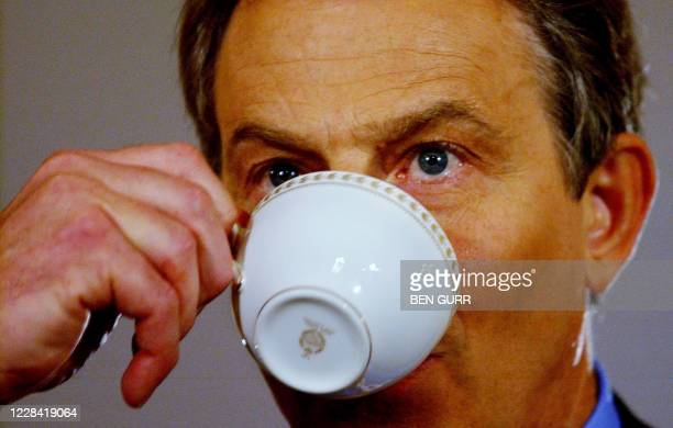 Britain's Prime Minister Tony Blair sip tea during his monthly news conference at No. 10 Downing Street in London 06 January, 2005. Blair said...
