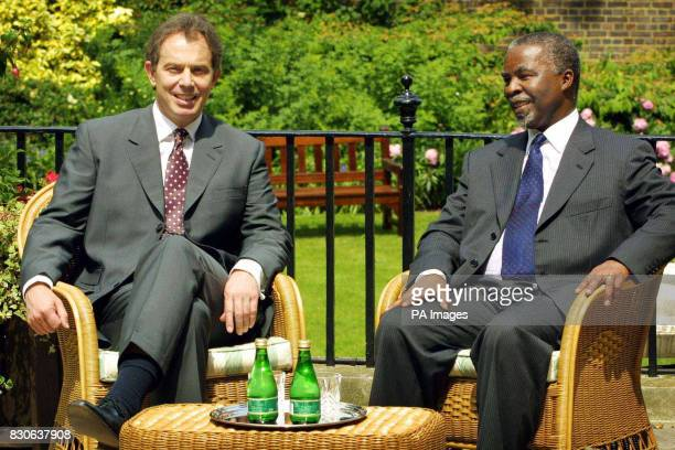 Britain's Prime Minister Tony Blair sits with Thabo Mbeki President of the Republic of South Africa in the garden at No 10 Downing Street in London...