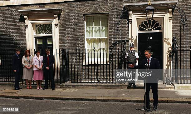 Britain's Prime Minister Tony Blair speaks to the media watched by son Nicky daughter Kathryn wife Cherie and son Euan after returning to 10 Downing...