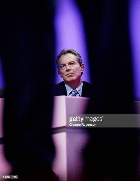 Britain's Prime Minister Tony Blair watches as Britain's Chancellor of the Exchequer Gordon Brown hold his keynote speech during the second day of...