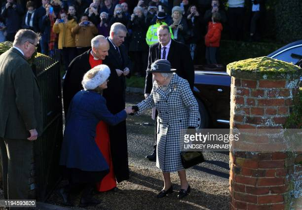 Britain's Prince Andrew Duke of York accompanies Britain's Queen Elizabeth II as she arrives at St Mary the Virgin Church in Hillington Norfolk...