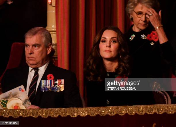 Britain's Prince Andrew Duke of York and Britain's Catherine Duchess of Cambridge attend the annual Royal Festival of Remembrance at the Royal Albert...