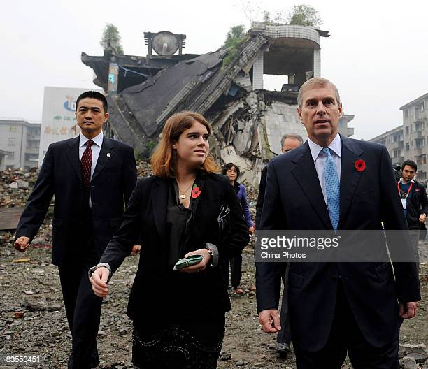 Britain's Prince Andrew Duke of York and his daughter Princess Eugenie visit the debris to dedicate flowers to the deceased of the 'Sichuan's May 12...
