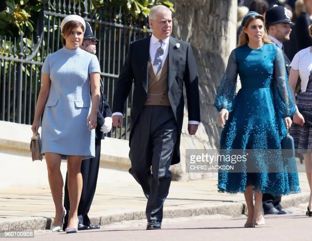 Britain's Prince Andrew Duke of York and his daughters Britain's Princess Eugenie of York and Britain's Princess Beatrice of York arrive for the...