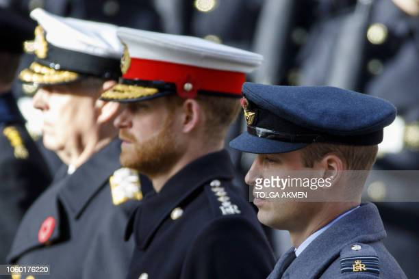 TOPSHOT Britain's Prince Andrew Duke of York Britain's Prince Harry Duke of Sussex and Britain's Prince William Duke of Cambridge stand at the...