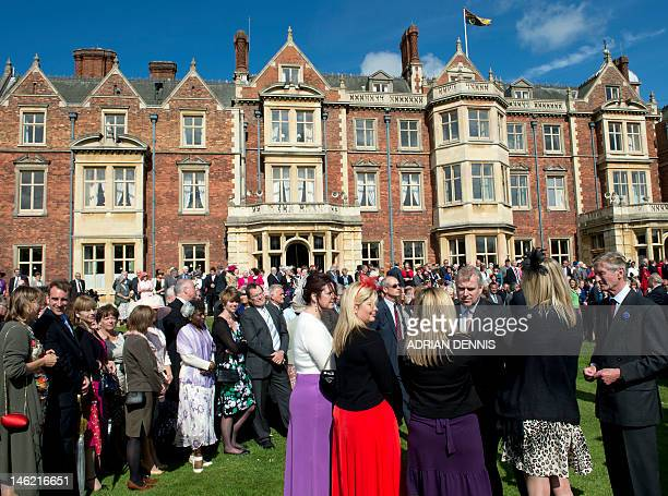 Britain's Prince Andrew, Duke of York greets guests at a garden party in honour of Britain's Queen Elizabeth II's diamond jubilee at the Queen's...