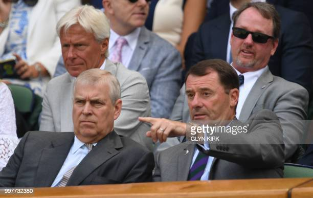 Britain's Prince Andrew Duke of York sits in the Royal box on Centre Court to watch US player John Isner play South Africa's Kevin Anderson during...