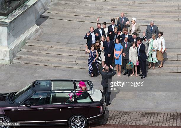 Britain's Prince Andrew Duke of York takes a picture of members of the Royal family including Britain's Princess Eugenie of York Britain's Princess...