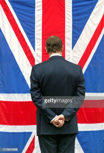 Britain's Prince Andrew the third child and second son of Queen Elizabeth and Prince Philip salutes the Union Jack 12 September 2003 while visiting...
