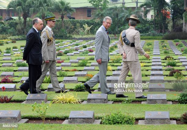 Britain's Prince Charles and British ambassador to Indonesia Martin Hatfull walk through the graveyard during a visit to the Pulo Menteng...
